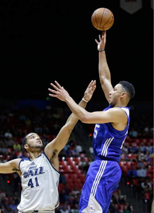 Philadelphia 76ers forward Ben Simmons, right, shoots as Utah Jazz forward Trey Lyles (41) defends during the second half of an NBA summer league basketball game against the Utah Jazz on Thursday, July 7, 2016, in Salt Lake City. (AP Photo/Rick Bowmer)