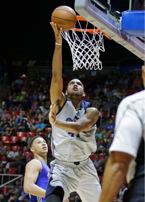 Utah Jazz forward Trey Lyles, left, lays the ball up as Philadelphia 76ers forward Ben Simmons, left, looks on during the second half of an NBA summer league basketball game Thursday, July 7, 2016, in Salt Lake City. (AP Photo/Rick Bowmer)