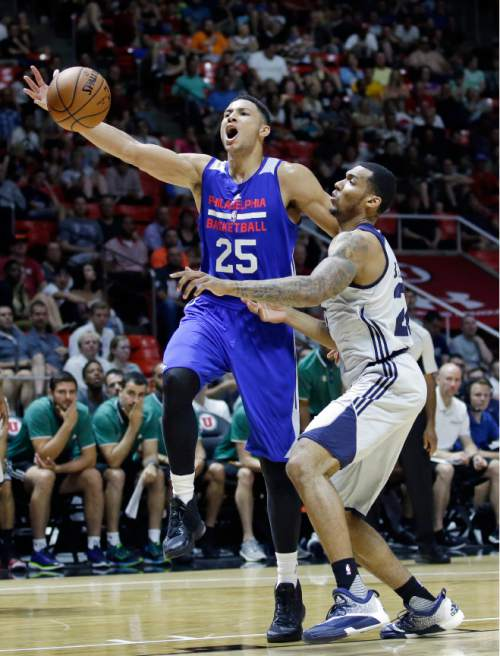 Philadelphia 76ers forward Ben Simmons (25) goes to the basket as Utah Jazz forward Joel Bolomboy, right, defends during the second half of an NBA summer league basketball game Thursday, July 7, 2016, in Salt Lake City. (AP Photo/Rick Bowmer)