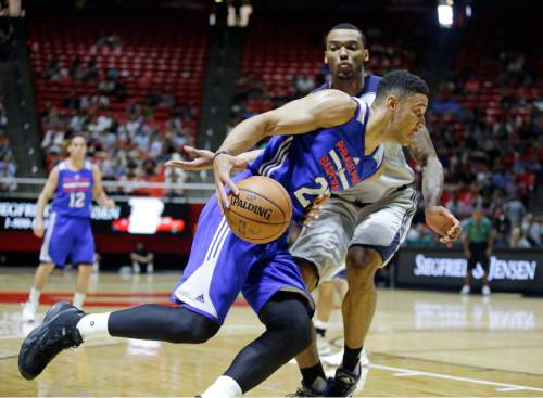 Philadelphia 76ers forward Ben Simmons (25) drives around Utah Jazz forward Joel Bolomboy during the first half of an NBA summer ;eague basketball game Thursday, July 7, 2016, in Salt Lake City. (AP Photo/Rick Bowmer)