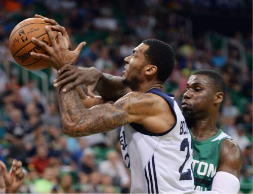 Steve Griffin / The Salt Lake Tribune  Utah Jazz forward Joel Bolomboy gets fouled as he goes to the basket during the Jazz versus Celtics summer league game at the Vivint Smart Home Arena in Salt Lake City Tuesday July 5, 2016.