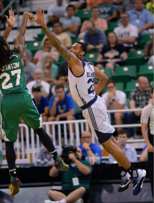 Steve Griffin / The Salt Lake Tribune  Utah Jazz forward Joel Bolomboy leaps out to try and contest the shot of Boston's Marcus Thornton during the Jazz versus Celtics summer league game at the Vivint Smart Home Arena in Salt Lake City Tuesday July 5, 2016.