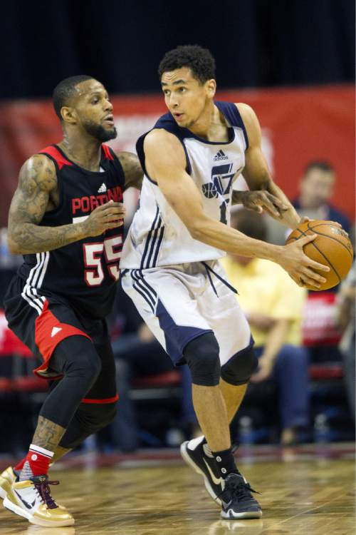 Utah Jazz's Marcus Paige (16) looks to make a play against Portland Trail Blazers' Pierre Jackson (55) during an NBA summer league basketball game Tuesday, July 12, 2016, in Las Vegas. (Erik Verduzco/Las Vegas Review-Journal via AP)