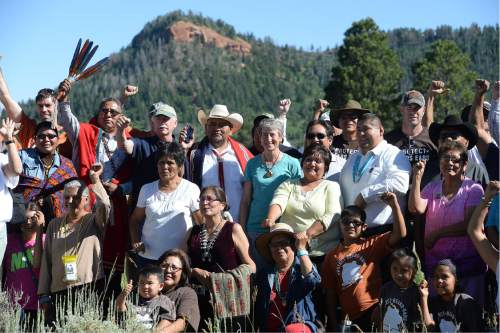 Scott Sommerdorf      The Salt Lake Tribune   With one of the Bears Ears in the background, U.S. Interior Secretary Sally Jewell poses with a large group of native people who support the creation of the Bears Ears National Monument, after a long meeting under a tent in a meadow atop the Bears Ears, Friday, July 15, 2016. The event included native dances and songs along with speeches from native people about how they are spiritually and culturally connected to the Bears Ears region.
