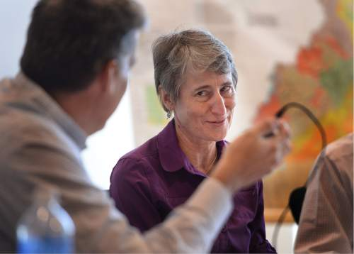 """Scott Sommerdorf      The Salt Lake Tribune   Interior Secretary Sally Jewell gives a wry look to San Juan County Commissioner Phil Lyman, left, when he mentioned that he hoped that decisions weren't being made in Washington D.C. by """"people looking at Google Maps"""" in a public meeting in Monticello, Thursday, July 14, 2016. Jewell assured him that's not how decisions get made."""