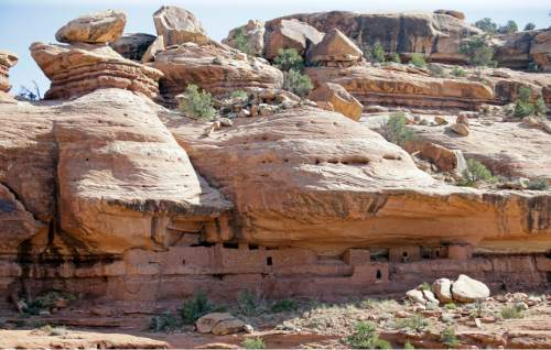 """The """"Moonhouse"""" in McLoyd Canyon is shown during U.S. Interior Secretary Sally Jewell tour Friday, July 15, 2016, near Blanding, Utah. Jewell is touring archaeological sites in southeast Utah that a coalition of American Indian tribes and environmental groups want to see protected as a new national monument. (AP Photo/Rick Bowmer)"""