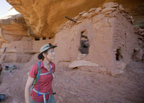 """U.S. Interior Secretary Sally Jewell tours the """"Moonhouse"""" in McLoyd Canyon Friday, July 15, 2016, near Blanding, Utah. Jewell is touring archaeological sites in southeast Utah that a coalition of American Indian tribes and environmental groups want to see protected as a new national monument. (AP Photo/Rick Bowmer)"""