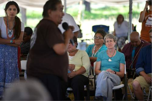 Scott Sommerdorf      The Salt Lake Tribune   U.S. Interior Secretary Sally Jewell listens as Mountain Ute Elder Norman Lopez begins to sing a native song after his talk about how he and his people are connected to the Bears Ears region during a long meeting under a tent a meadow atop the Bears Ears, Friday, July 15, 2016. She listened to many stories and speeches from native people who are for the the creation of the National Monument.