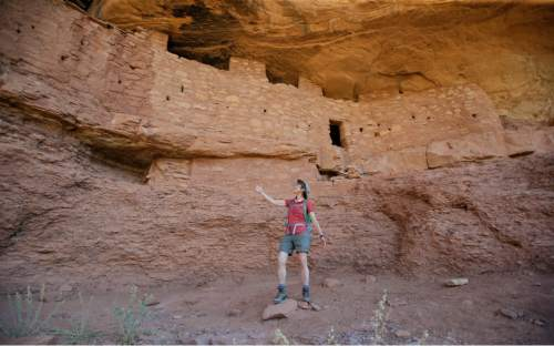 """U.S. Interior Secretary Sally Jewell tours the """"Moonhouse"""" in McLoyd Canyon, Friday, July 15, 2016, near Blanding, Utah. Jewell is touring archaeological sites in southeast Utah that a coalition of American Indian tribes and environmental groups want to see protected as a new national monument. (AP Photo/Rick Bowmer)"""