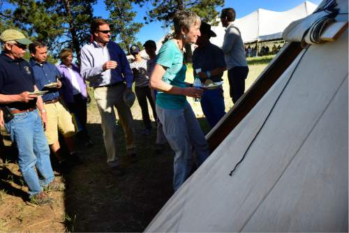 Scott Sommerdorf      The Salt Lake Tribune   U.S. Interior Secretary Sally Jewell head into a teepee to have dessert with tribal elders after a long meeting under a tent a meadow atop the Bears Ears, Friday, July 15, 2016. In the earlier meeting she listened to many stories and speeches from native people who are for the the creation of the National Monument.