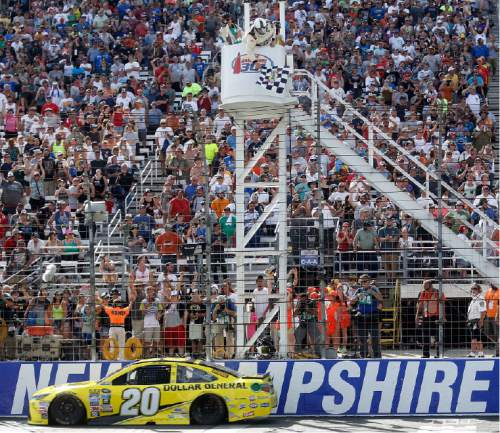 NASCAR driver Matt Kenseth gets the checkered flag to win the New Hampshire 301 auto race at New Hampshire Motor Speedway Sunday, July 17, 2016, in Loudon, N.H. (AP Photo/Jim Cole)