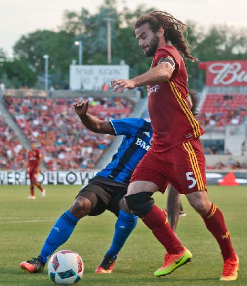 Michael Mangum  |  Special to the Tribune  Real Salt Lake midfielder Kyle Beckerman (5) dribbles toward goal with pressure from Montreal Impact forward Michael Salazar (19) during their MLS match at Rio Tinto Stadium in Sandy, UT on Saturday, July 9th, 2016.