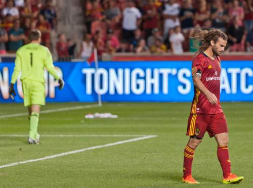 Michael Mangum  |  Special to the Tribune  Real Salt Lake midfielder Kyle Beckerman walks out of the 18-yard box following a blocked penalty kick by Seattle Sounders goalkeeper Tyler Miller, left, during their U.S. Open Cup match at Rio Tinto Stadium in Sandy, UT on Tuesday, June 28th, 2016. The match ended in a 1-1 draw with Seattle advancing after winning in a penalty kick shootout.