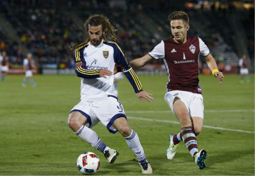 Real Salt Lake midfielder Kyle Beckerman, left, pursues the ball with Colorado Rapids forward Kevin Doyle in the second half of an MLS soccer game in Commerce City, Colo., late Saturday, May 7, 2016. The Rapids won 1-0. (AP Photo/David Zalubowski)