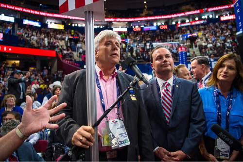 Trent Nelson  |  The Salt Lake Tribune Phil Wright and Senator Mike Lee, during a dispute over the adoption of rules at the 2016 Republican National Convention in Cleveland, OH, Monday July 18, 2016. Lee's wife Sharon is at right.