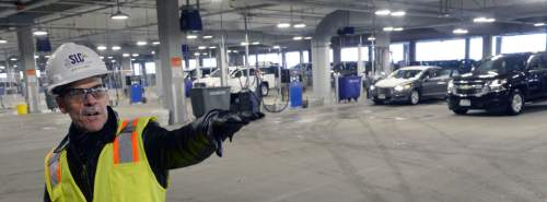 Al Hartmann  |  The Salt Lake Tribune  Mike Williams, terminal redevelopment program director shows the newly opened quick turn around facility for returned rental cars at Salt Lake International Airport Monday March 28.  The airport just just completed the car rental maintainence facility a couple months ago.  It is an early part of the $1.8 billion terminal redevelop program.