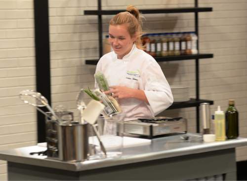 """Steve Griffin / The Salt Lake Tribune  Kortney Stevens racing to her cooking station, during auditions for season 2 of """"TeenChef Pro,"""" a cooking show produced by the Utah Restaurant Association and filmed at the Salt Lake Community College's South Campus."""
