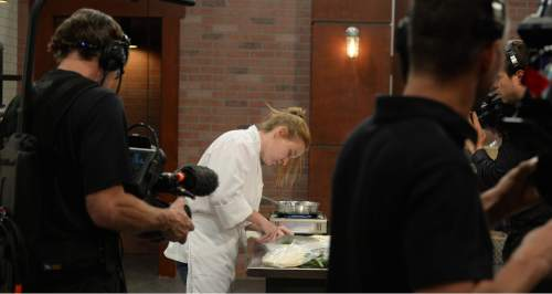 """Steve Griffin / The Salt Lake Tribune  Kortney Stevens chops dill during auditions for season 2 of """"TeenChef Pro,"""" a cooking show produced by the Utah Restaurant Association. State funding was originally vetoed by Gov.Gary Herbert, but restored by the Utah Legislature."""