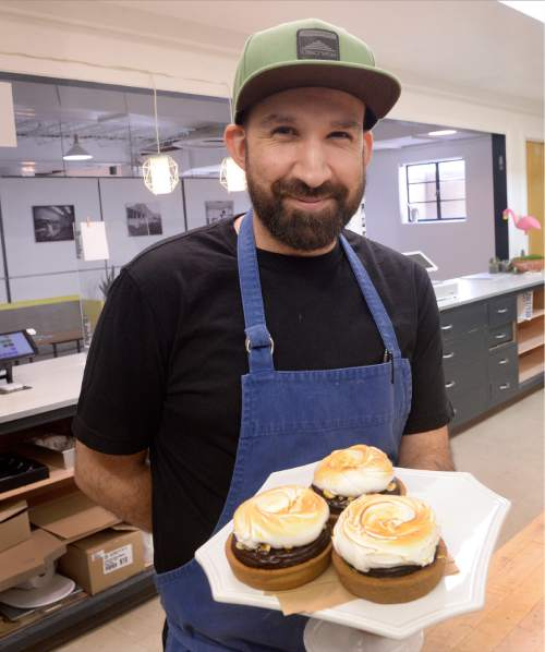 Al Hartmann  |  The Salt Lake Tribune  Andrew Young, owner of Bubble and Brown Bakery in Salt Lake City with his Hazelnut S'more Tarts.