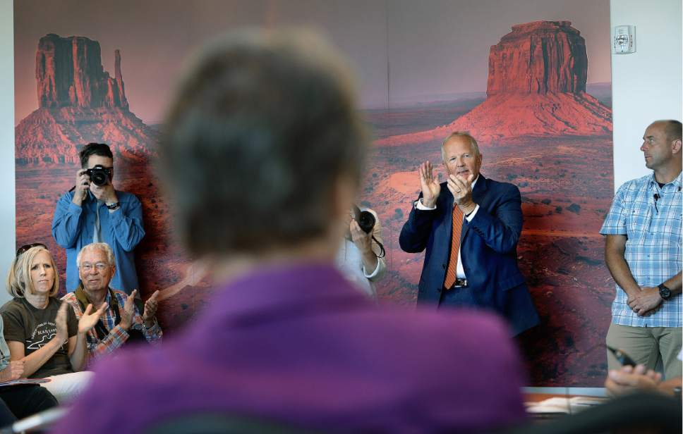 Scott Sommerdorf   |  The Salt Lake Tribune   Utah state Representative Mike Noel, R-Kanab, applaudes after a speech against the Bears Ears monument by one of the San Juan County commissioners. Interior Secretary Sally Jewell, foreground, attended a public meeting with the San Juan County Commissioners in Monticello, Thursday, July 14, 2016.