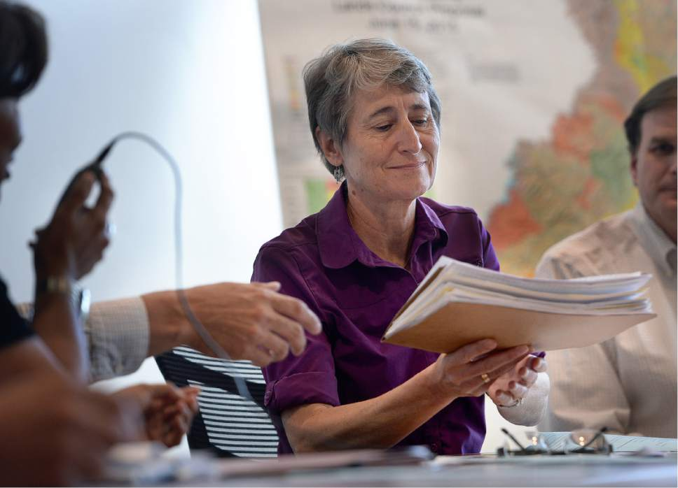 Scott Sommerdorf   |  The Salt Lake Tribune   Interior Secretary Sally Jewell is handed a large folder of letters against the Bears Ears National Monument at a meeting with the San Juan County Commissioners in a public meeting in Monticello, Thursday, July 14, 2016.