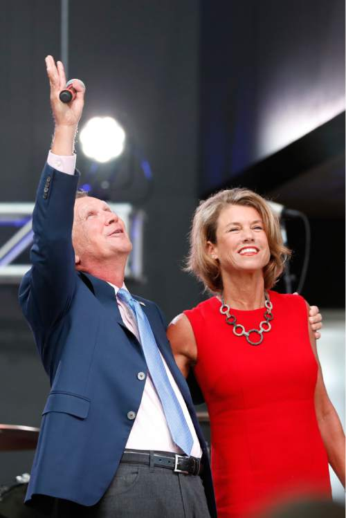 Ohio Gov. John Kasich, left, waves to supporters as his wife Karen listens at the The Rock and Roll Hall of Fame and Museum on Tuesday, July 19, 2016, in Cleveland, during the second day of the Republican convention. (AP Photo/Alex Brandon)