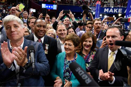 Trent Nelson  |  The Salt Lake Tribune Utah delegation votes in the roll call of the states to pick the Republican nominee at the 2016 Republican National Convention in Cleveland,  Tuesday July 19, 2016. Left to right are Phill Wright, James Evans, Gov. Gary Herbert, Jeanette Herbert, Sharon Lee and Sen. Mike Lee.