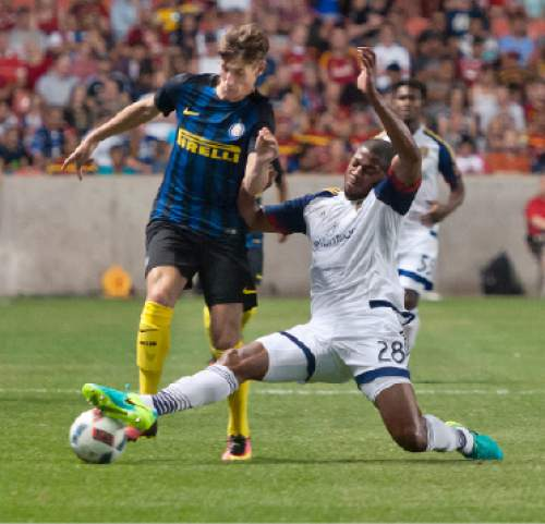 Michael Mangum  |  Special to the Tribune  Real Salt Lake defender Chris Schuler (28) slide tackles Inter Milan forward Andrea Pinamonti (99) during their international friendly at Rio Tinto Stadium in Sandy, Utah on Tuesday, July 19th, 2016. Inter won on a last second goal 2-1.