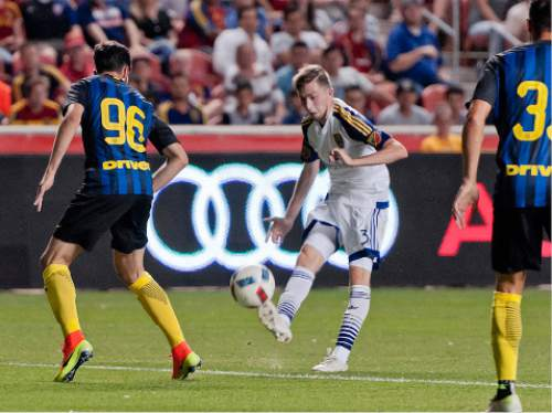 Michael Mangum  |  Special to the Tribune  Real Salt Lake forward Andrew Brody (31) sends a pass into the box in front of Inter Milan defender Fabio Della Giovanna (96) during their international friendly at Rio Tinto Stadium in Sandy, Utah on Tuesday, July 19th, 2016. Inter won on a last second goal 2-1.
