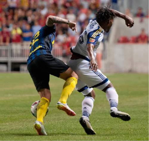 Michael Mangum  |  Special to the Tribune  Inter Milan midfielder Daniel Bessa (12), left, and Real Salt Lake forward Kevaughn Frater (55) battle for possession during their international friendly at Rio Tinto Stadium in Sandy, Utah on Tuesday, July 19th, 2016. Inter won on a last second goal 2-1.
