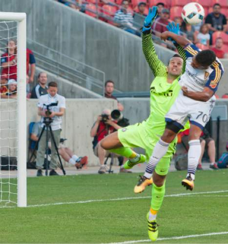 Michael Mangum  |  Special to the Tribune  Inter Milan goalkeeper Samir Handanovic (1) and Real Salt Lake midfielder Jordan Allen (70) fly up for the ball near the Inter goal during their international friendly at Rio Tinto Stadium in Sandy, Utah on Tuesday, July 19th, 2016.