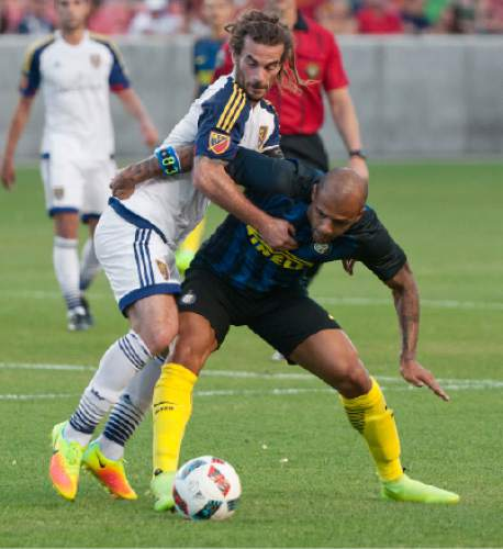 Michael Mangum  |  Special to the Tribune  Real Salt Lake midfielder Kyle Beckerman (5) and Inter Milan midfielder Felipe Melo (5) tossle for possession during their international friendly at Rio Tinto Stadium in Sandy, Utah on Tuesday, July 19th, 2016.