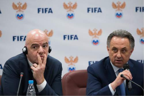FILE - In this April 19, 2016 file photo FIFA President Gianni Infantino, left, listens as Russian Sports Minister Vitaly Mutko speaks during a news conference in Moscow, Russia. (AP Photo/Alexander Zemlianichenko)