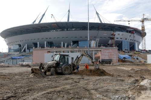 In this Tuesday, April 5, 2016 file photo the stadium which will host some 2018 World Cup matches, under construction in St.Petersburg, Russia. Russian President Vladimir Putin on Monday, July 18, 2016, has ordered officials in St. Petersburg to speed up construction of a trouble-plagued stadium, which is scheduled to host matches during the 2018 World Cup, including a semifinal. (AP Photo/Dmitri Lovetsky, file)
