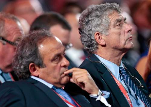 FILE - In this Saturday, July 25, 2015 file photo, UEFA President Michel Platini, left, and FIFA vice president Angel Maria Villar Llona attend the preliminary draw for the 2018 soccer World Cup in Konstantin Palace in St. Petersburg, Russia. Angel Maria Villar, UEFA's longest-serving vice president, is standing in the election to succeed Michel Platini as head of European soccer. The Spanish federation president announced his candidacy Tuesday, July 19, 2016 ahead of Wednesday's deadline for September's UEFA presidential election. (AP Photo/Ivan Sekretarev, File)