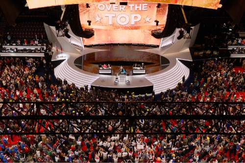 The large television monitor announces that after the New York delegation casts their votes that Donald Trump has enough votes to become the nominee of the Republican Party for President of the United States during the second day of the Republican National Convention in Cleveland, Tuesday, July 19, 2016. (AP Photo/Mark J. Terrill)