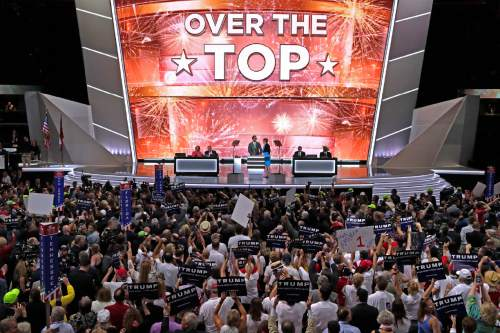 The large television monitor announces that after the New York delegation casts their votes that Donald Trump has enough votes to become the nominee of the Republican Party for President of the United States during the second day of the Republican National Convention in Cleveland, Tuesday, July 19, 2016. (AP Photo/J. Scott Applewhite)