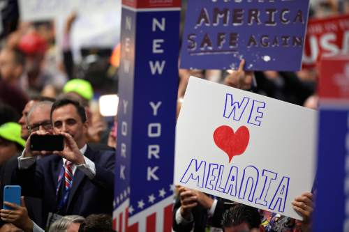 A supporter of Melania Trump holds a sign during the second day of the Republican National Convention in Cleveland, Tuesday, July 19, 2016. (AP Photo/Mark J. Terrill)