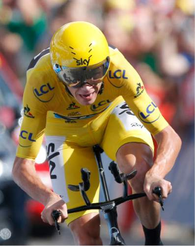 Britain's Chris Froome, wearing the overall leader's yellow jersey crosses the finish line to win the eighteenth stage of the Tour de France cycling race, an individual time trial over 17 kilometers (10.6 miles) with start in Sallanches and finish in Megeve, France, Thursday, July 21, 2016. (AP Photo/Christophe Ena)
