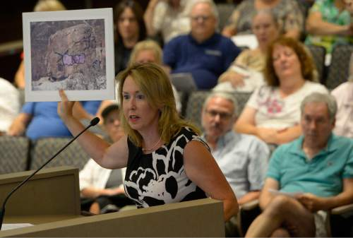 Leah Hogsten  |  Tribune file photo During a June 30, 2015, hearing, Jemina Keller shows the Salt Lake County Council pictures of vandalism, graffiti and other problems Millcreek Canyon faces, especially the Grandeur Peak trailhead and open space in Millcreek. The council on Tuesday night, July 19, held another hearing on parking issues in the area but took no action.