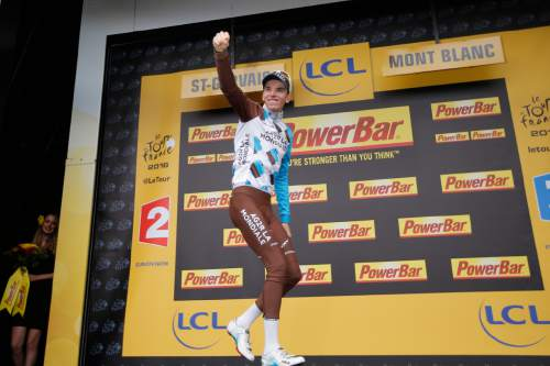 Stage winner France's Romain Bardet celebrates on the podium after the nineteenth stage of the Tour de France cycling race over 146 kilometers (90.7 miles) with start in Albertville and finish in Saint-Gervais Mont Blanc, France, Friday, July 22, 2016. (AP Photo/Christophe Ena)