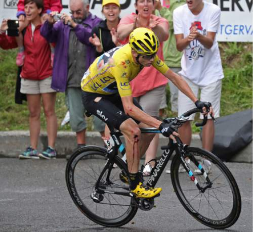 Britain's Chris Froome, wearing his torn overall leader's yellow jersey, bleeds after crashing during the nineteenth stage of the Tour de France cycling race over 146 kilometers (90.7 miles) with start in Albertville and finish in Saint-Gervais Mont Blanc, France, Friday, July 22, 2016. (Keno Tribouillard via AP Photo)