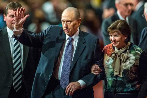 Chris Detrick     The Salt Lake Tribune LDS Church President Thomas S. Monson walks off of the stage with his daughter Ann M. Dibb during afternoon session of the 185th LDS General Conference at  the Conference Center in Salt Lake City Saturday October 3, 2015.