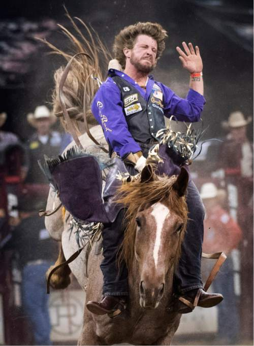 Rick Egan  |  The Salt Lake Tribune  Tilden Hooper, Carthage, TX, rides in the Bareback competition, in the Days of 47 Rodeo, at Vivint Smart Home Arena, Saturday, July 23, 2016.
