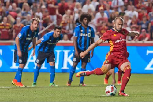 Michael Mangum     Special to the Tribune  Real Salt Lake forward Yura Movsisyan (14) takes a penalty kick during the second half of their MLS match against the Montreal Impact at Rio Tinto Stadium in Sandy, UT on Saturday, July 9th, 2016. Movsisyan scored with the kick and the match ended in a 1-1 draw.