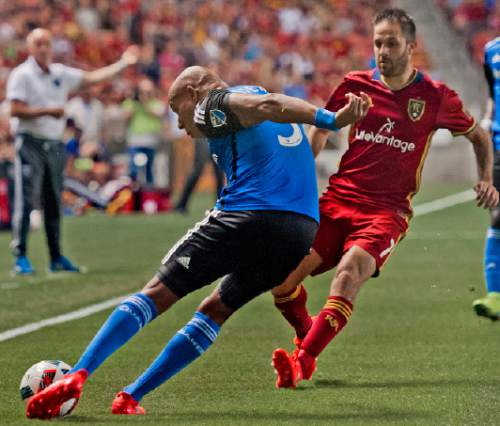 Michael Mangum     Special to the Tribune  San Jose defender Jordan Stewart (3) clears out the ball in front of Real Salt Lake forward Juan Manuel Martinez (7) during their MLS match at Rio Tinto Stadium in Sandy, Utah on Friday, July 22nd, 2016.