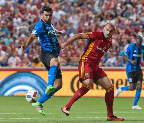 Michael Mangum     Special to the Tribune  Montreal Impact defender Victor Cabrera (36) intercepts a pass intended for Real Salt Lake forward Yura Movsisyan (14) at the edge of the 18-yard box during their MLS match at Rio Tinto Stadium in Sandy, UT on Saturday, July 9th, 2016. Montreal stymied RSL's attack and the match ended in a 1-1 draw.