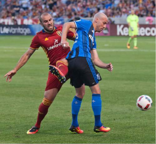 Michael Mangum     Special to the Tribune  Real Salt Lake forward Yura Movsisyan (14) challenges Montreal Impact defender Laurent Ciman (23) for the ball during their MLS match at Rio Tinto Stadium in Sandy, UT on Saturday, July 9th, 2016.
