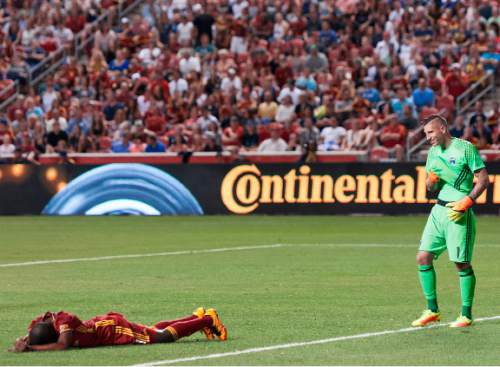Michael Mangum     Special to the Tribune  Real Salt Lake defender Aaron Maund (21) lies on the ground after a collision as San Jose goalkeeper David Bingham (1) looks on during their MLS match at Rio Tinto Stadium in Sandy, Utah on Friday, July 22nd, 2016.