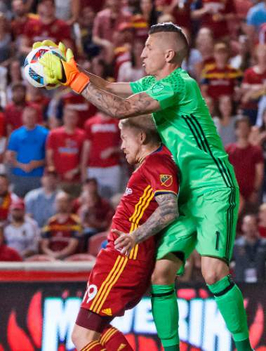 Michael Mangum     Special to the Tribune  San Jose goalkeeper David Bingham (1) grabs the ball out of the air over Real Salt Lake midfielder Luke Mulholland (19) during their MLS match at Rio Tinto Stadium in Sandy, Utah on Friday, July 22nd, 2016.